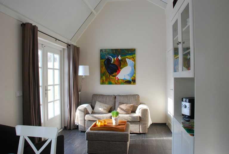 Blandinushof gastenverblijf: woonkamer vanaf keuken